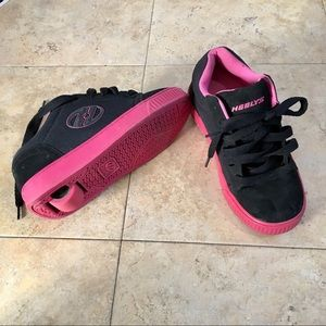 HEELYS!!!  Shoes with the wheel on bottom!